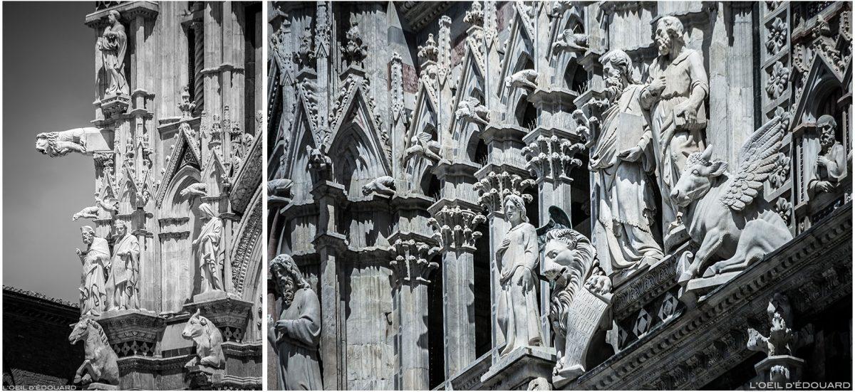 Estátuas de esculturas na fachada gótica da Catedral de Siena Duomo Santa di Siena (Santa Maria Assunta)