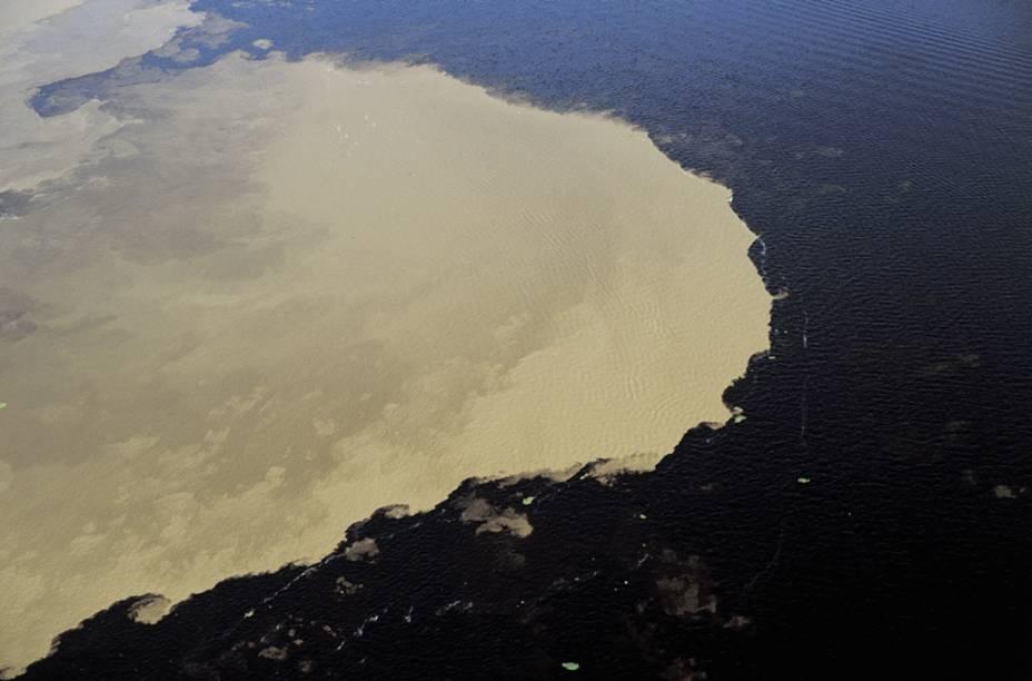 """Testemunha""""http://viajeaqui.abril.com.br/estabelecimentos/br-am-manaus-atracao-encontro-das-aguas"""" rel =""""Encontro Águas do Rio Negro com Rio Solimões"""" Objetivo =""""_vazio""""> O encontro da Águas do Rio Negro com o Rio Solimões (AM) é um atrativo oferecido pelas agências de viagens.  Verifique no link o GUIA QUATRO RODAS"""" class=""""lazyload"""" data-pin-nopin=""""true""""/></div> <p class="""